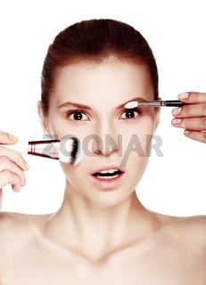 Beautiful woman applying make-up.