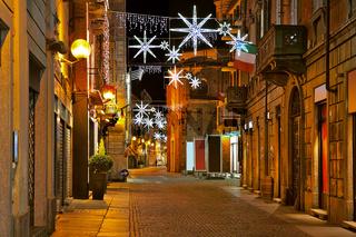 Central street at evening. Alba, Italy.