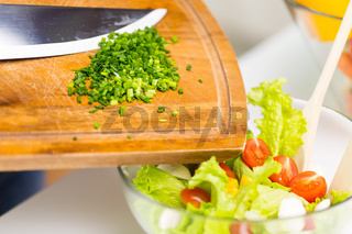 close up of chopped onion and vegetable salad