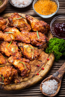 BBQ chicken wings with spices and dips