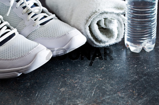 sport concept. towel, shoes and water in bottle