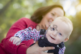 Little Baby Boy Having Fun With Mommy Outdoors