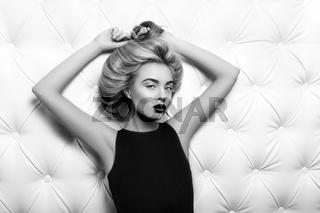 Studio portrait of a sexy blond in black dress