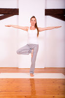 Woman practicing Yoga in a Studio