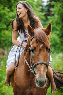 beautiful woman riding horse