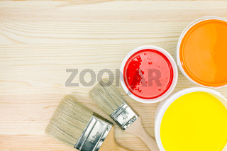 paintbrushes and opened paint cans