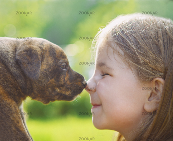Little girl with a puppy