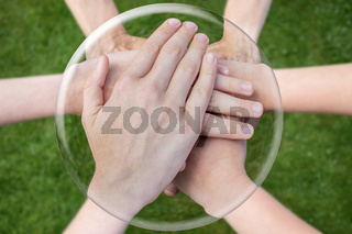 Hands arms uniting in glass sphere