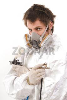 Worker with airbrush gun