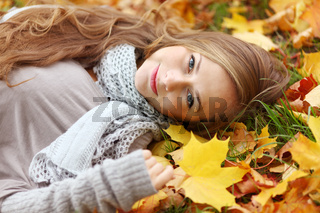 Woman on autumn leaves