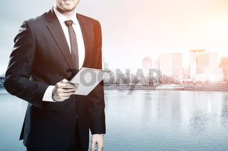 businessman with tablet on cityscape and skyline of portland