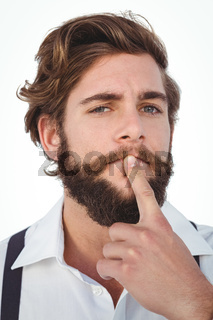 Portrait of hipster with finger on chin