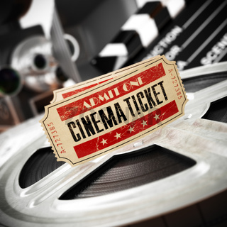 Movie, cinema vintage concept. Tickets on retro film reels and boxes.