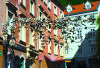 Shoes hanging in the Old Town of Ljubljana