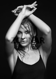 Woman with wet shining  makeup  on black background