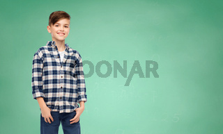 smiling boy in checkered shirt and jeans