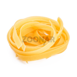 Pasta tagliatelle nest isolated on white
