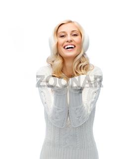 woman in winter earmuffs showing empty palms