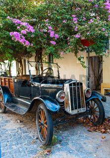 Cobblestone street and old car in Historic neighborhood in Colonia del Sacramento, Unesco World Heritage town, Uruguay.