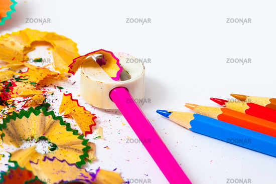 set of colored pencils, sharpener and shavings