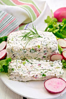 Terrine of curd and radishes in dish on board