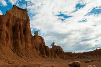 Big orange sand stone cliff in dry hot tatacoa desert with Cactus, Huila