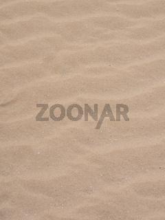 Wellenmuster vom Wind im Sand als Hintergrund