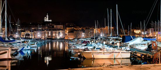 Marseille, France panorama at night, the harbour and cathedral.