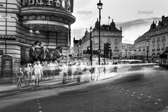 Crowd of people crossing road, Picadilly Circus in black and white, London, United Kingdom