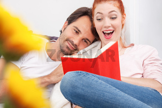 Sweet Young Couple Reading a Book Together