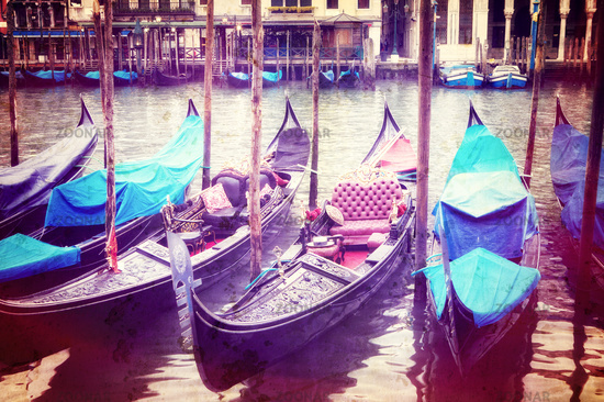 Retro style image of Venice seafront with gondolas on the waves