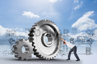 Composite image of businessman bending and pushing