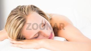 Beautiful blonde lying on massage table