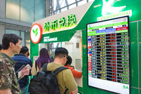 tourists exchange money at Suvernabhumi airport