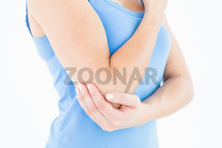 Woman touching her painful elbow