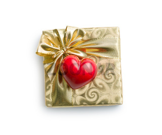 gold gift box with red heart