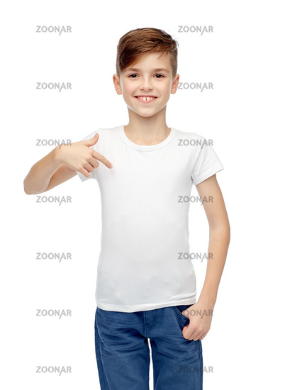 happy boy pointing finger to his white t-shirt