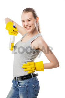 Young woman with cleansing spray isolated on white