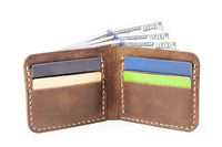 brown leather wallet with money isolated on white