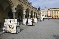 Paintings display next to Sukiennice Krakow