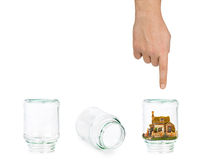 House and shell game with glass jars