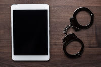 handcuffs and tablet computer