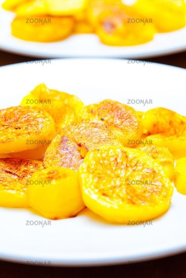 slices of baked potatoes on a white plate