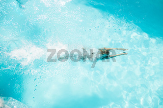 Woman diving in the pool