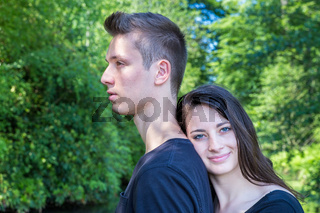Young attractive woman leaning head on back of man