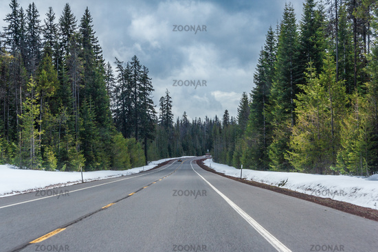 Highway running through forests of Oregon covered with snow USA
