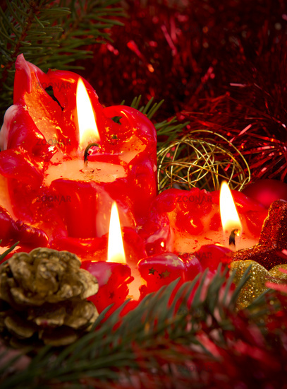 Three red Advent candles .
