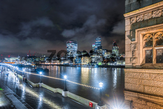 City across River Thames from Towerbridge at night, London, United Kingdom