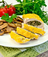 Roll chicken with champignons on napkin