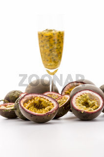 Halved Passionfruits And Fruit Pulp In A Glass